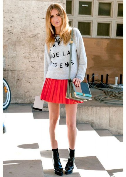 grey printed crew neck sweatshirt with orange pleated mini skirt