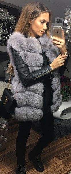 grey sleeveless faux fur bubble coat with black leather jacket