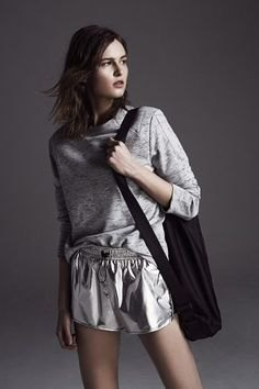 grey sweatshirt with silver metallic flowy shorts