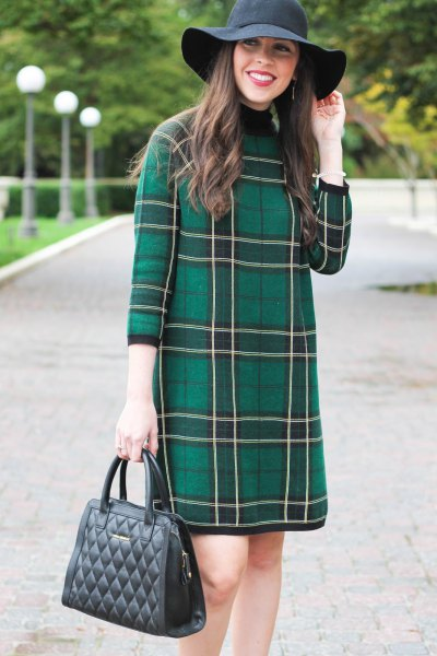 grey tartan three quarter sleeve mini dress with black floppy hat