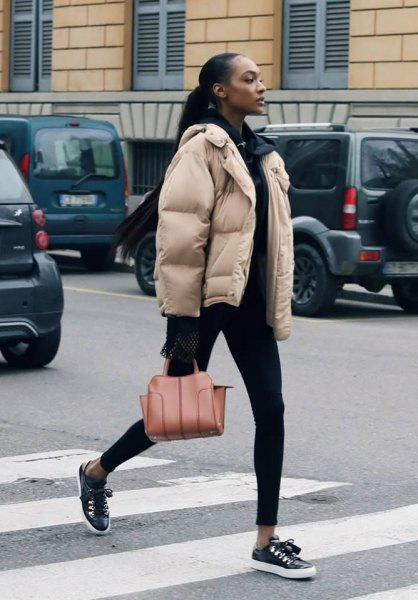 ivory bubble coat with all black outfit