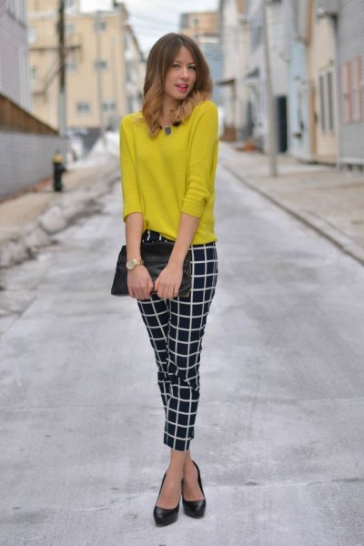lemon yellow knit sweater with black and white plaid ankle pants