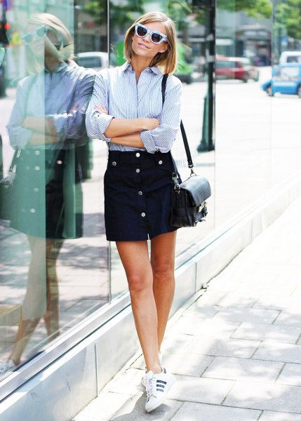 light blue and white striped button up shirt with black mini skirt