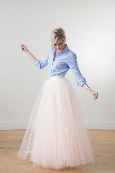 light blue button up shirt with white high waisted floor length flowy skirt