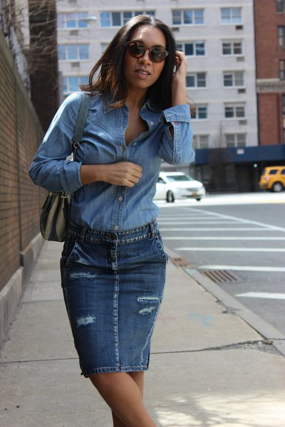 light blue chambray shirt with denim ripped skirt