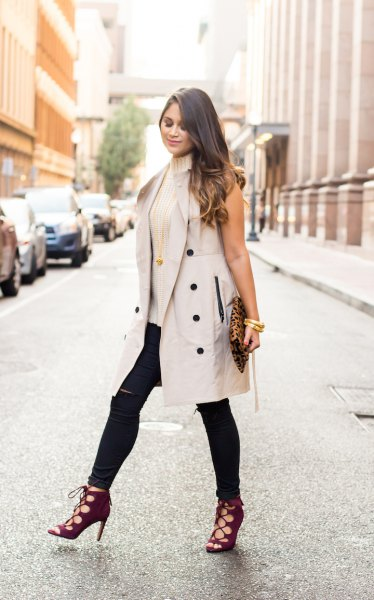 light grey sleeveless trench coat with pink turtleneck sweater