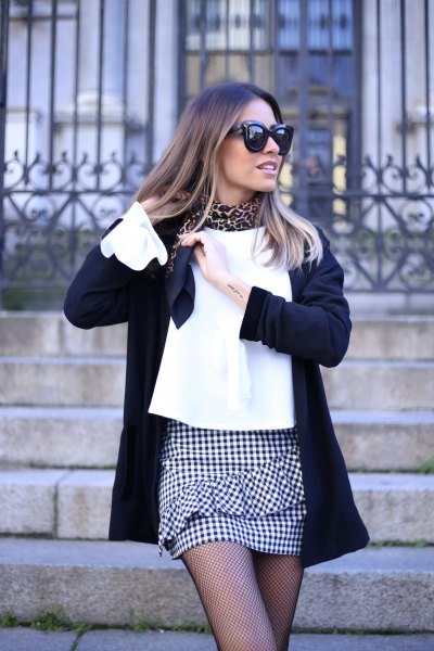 mini skirt with white blouse and black wool coat