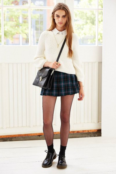 navy and green plaid mini skirt with white ribbed knit sweater
