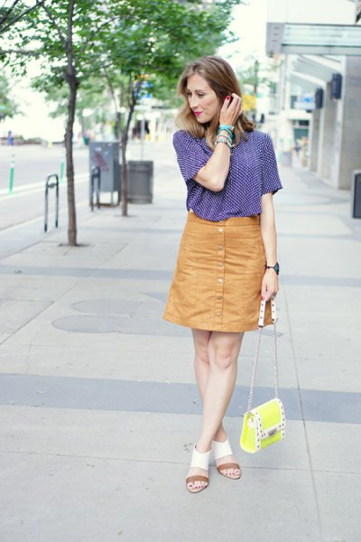 navy and white patterned short sleeve shirt with orange button down skirt
