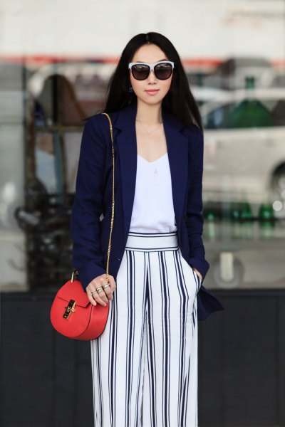 navy blazer with white vest top and striped wide leg pants