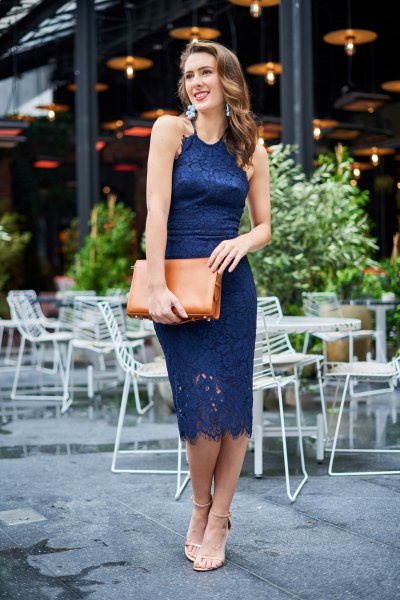navy midi bodycon lace dress with brown clutch bag