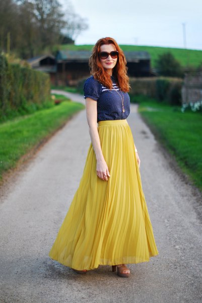 navy short sleeve blouse with lemon yellow maxi pleated skirt