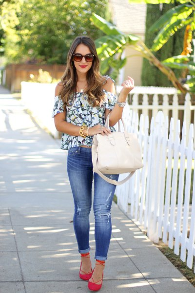 orange flats with white off the shoulder floral blouse