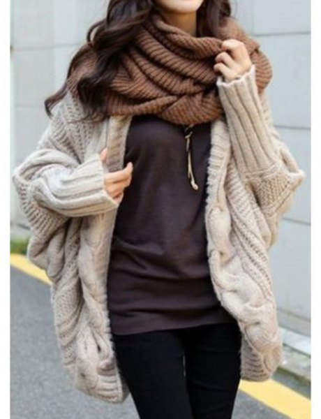 pale pink chunky knit cardigan with green scarf