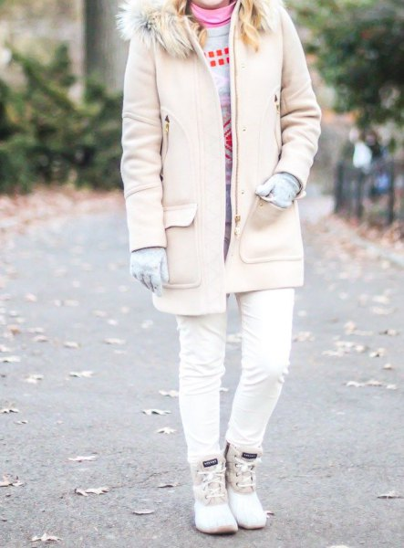 pale pink faux fur collar long coat with skinny jeans and white duck boots