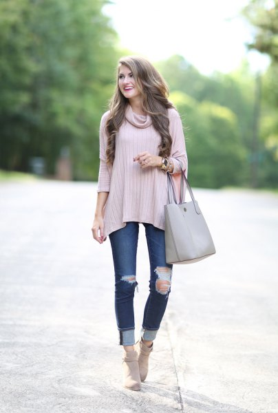 pale pink ribbed poncho sweater with ribbed cuffed jeans