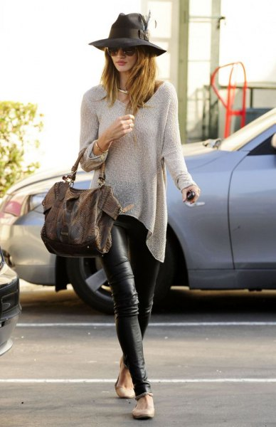 pale pink sweater and black leather leggings