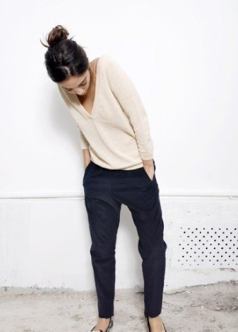 pale pink v neck sweater with black chinos