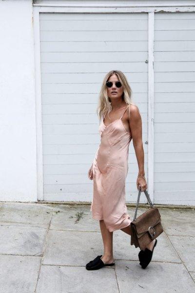 pink midi silk slip dress with black slide sandals