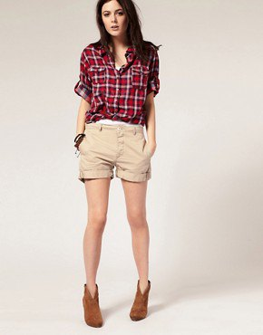 red and white plaid boyfriend shirt with beige cuffed shorts