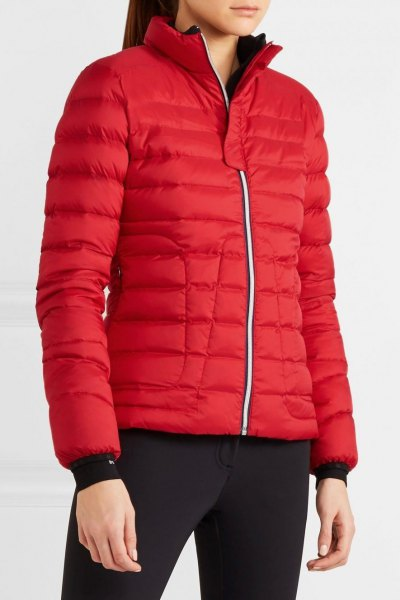 red bubble coat with black skinny jeans