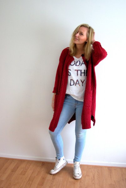 red long cardigan with white print tee and light blue skinny jeans