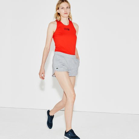 red vest top with grey fleece jogging shorts