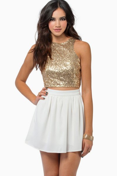 rose gold sequin cropped vest top with white mini skater skirt