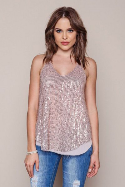 rose gold sequin vest top with blue jeans