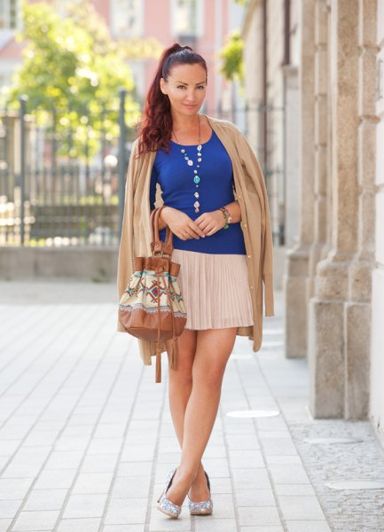 royal blue vest top with white pleated mini skirt