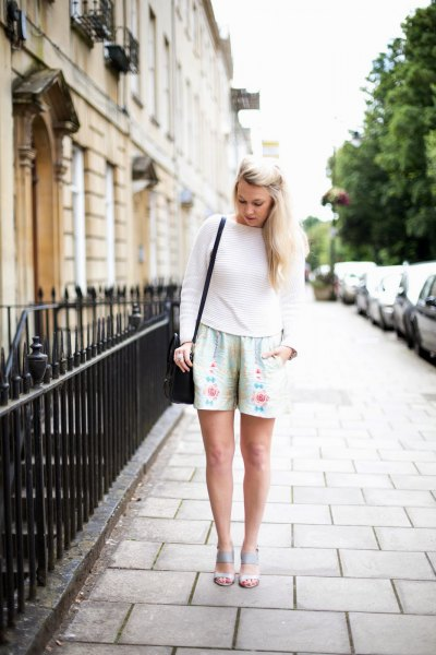 silver floral shorts with white crew neck knit sweater