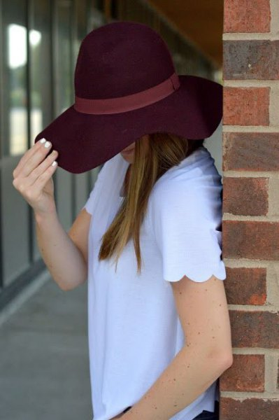 sky blue scalloped shirt with black floppy hat