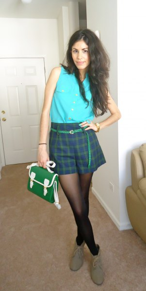 sky blue sleeveless button up shirt with navy and green plaid shorts