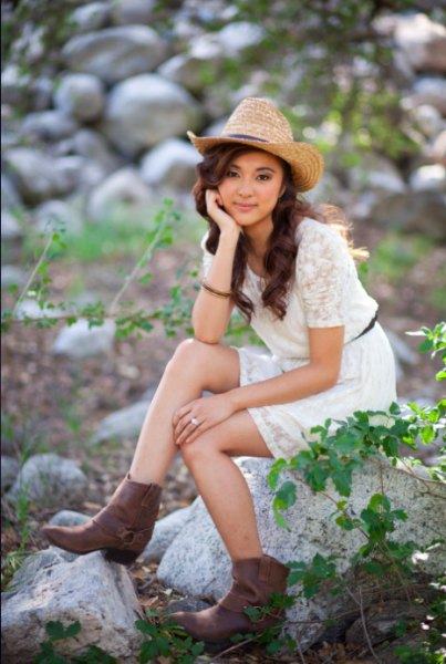 straw cowboy hat with white short sleeve belted mini lace dress