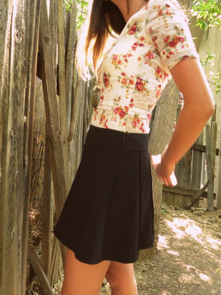 white and blush floral printed tee with black mini skirt