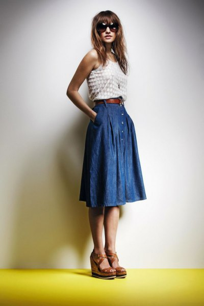white and pink polka dot vest top with blue pleated knee length denim skirt
