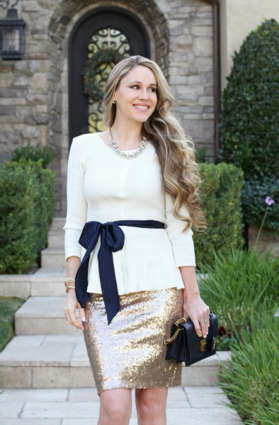white belted peplum sweater with rose gold sequin mini skirt
