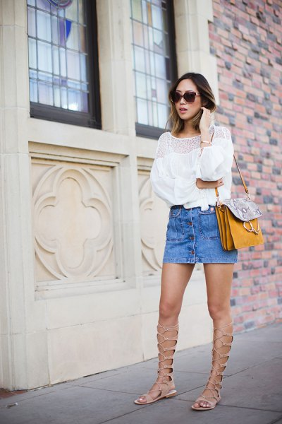white blouse with light blue mini denim skirt and gladiator sandals