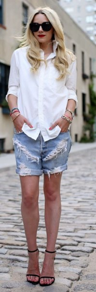 white button up shirt with blue ripped and cuffed denim boyfriend shorts