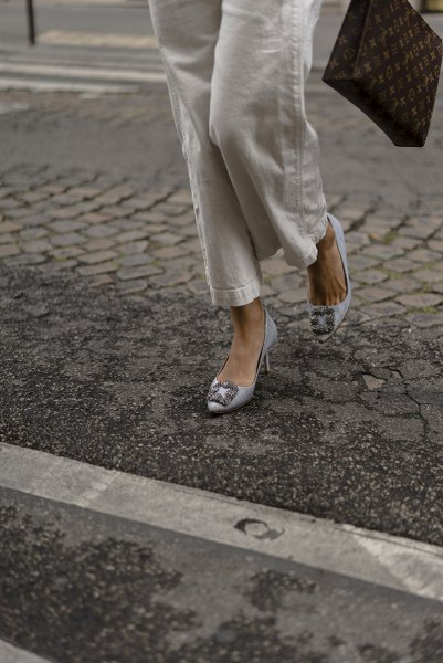 white button up shirt with linen pants and silver blue kitten heels