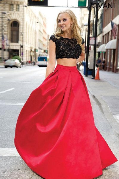 white cap sleeve cropped lace blouse with red floor length flared skirt