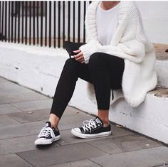 white chunky knit sweater with black ankle jeans