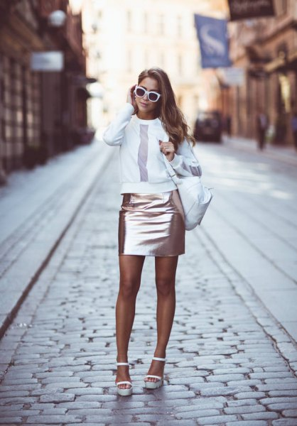 white crew neck sweatshirt with rose gold mini bodycon skirt