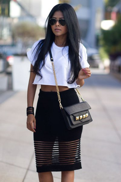 white cropped t shirt with black mesh knee length skirt