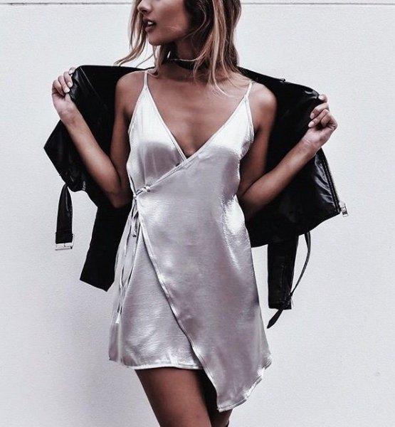 white deep v neck silk mini wrap dress with leather jacket