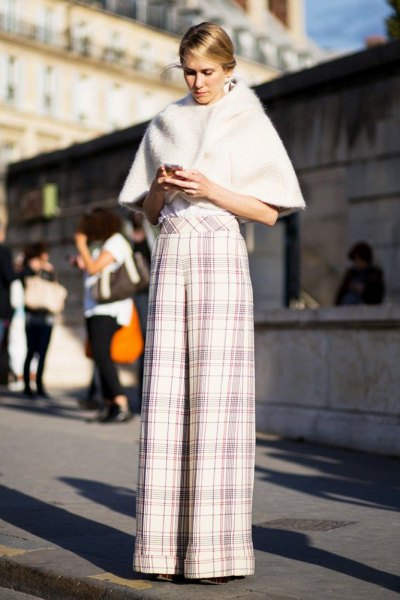 white faux fur cape with plaid palazzo pants