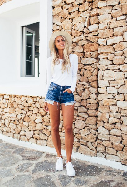 white fitted sweater with blue high waisted denim shorts