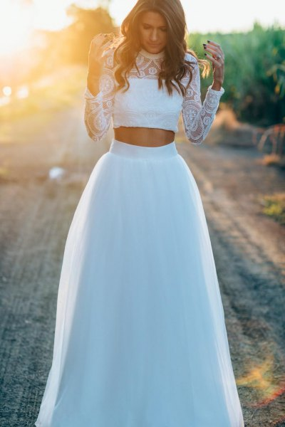 white lace cropped blouse with high waisted long white tulle skirt