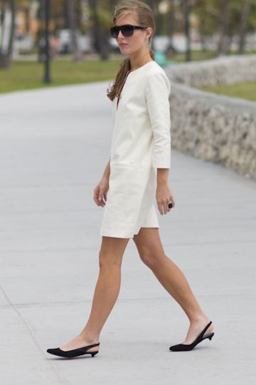 white long sleeve mini shirt dress with black kitten heel shoes