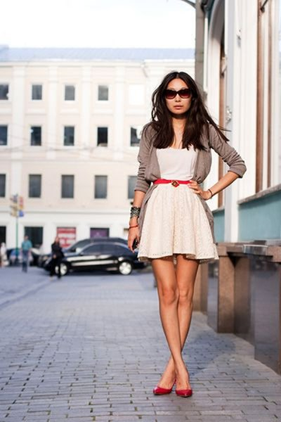 white mini skater dress with grey short blazer and red belt